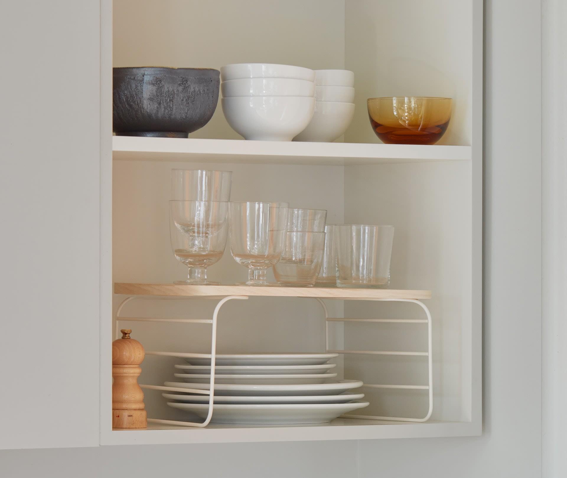Kitchen cabinet with shelf riser