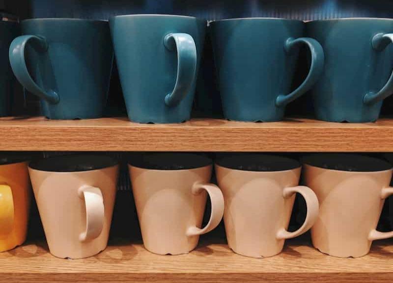 Mugs on kitchen shelves