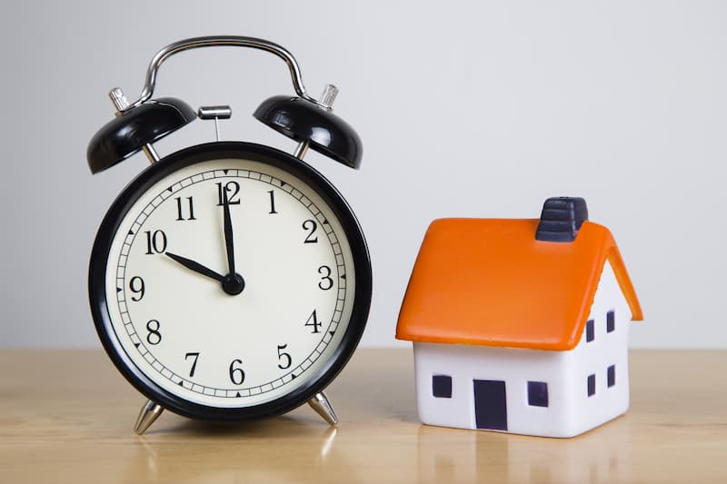 Alarm clock with small house