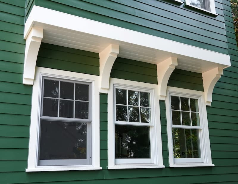 Green house with white trim