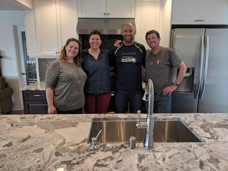 Happy kitchen remodel customers with the team