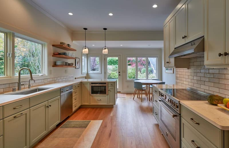 Remodeled kitchen with open shelves and two pendant lights
