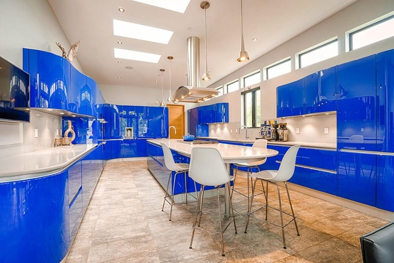 Contemporary kitchen with curved cabinets