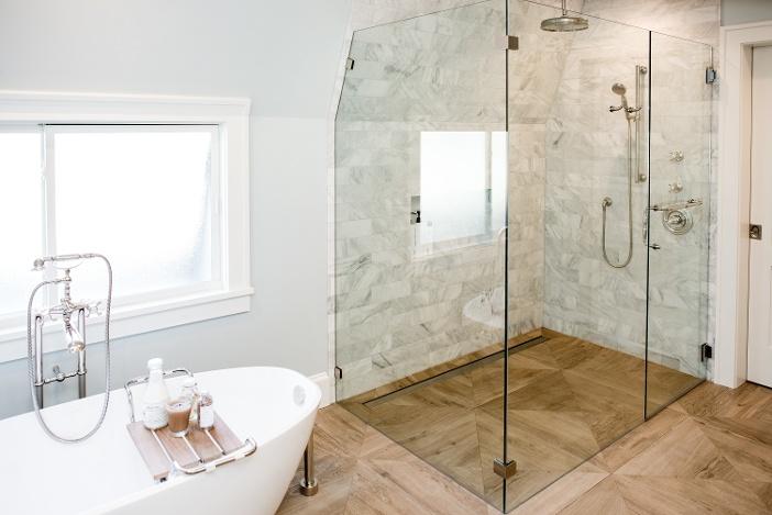 Wood grain tile in remodeled bathroom