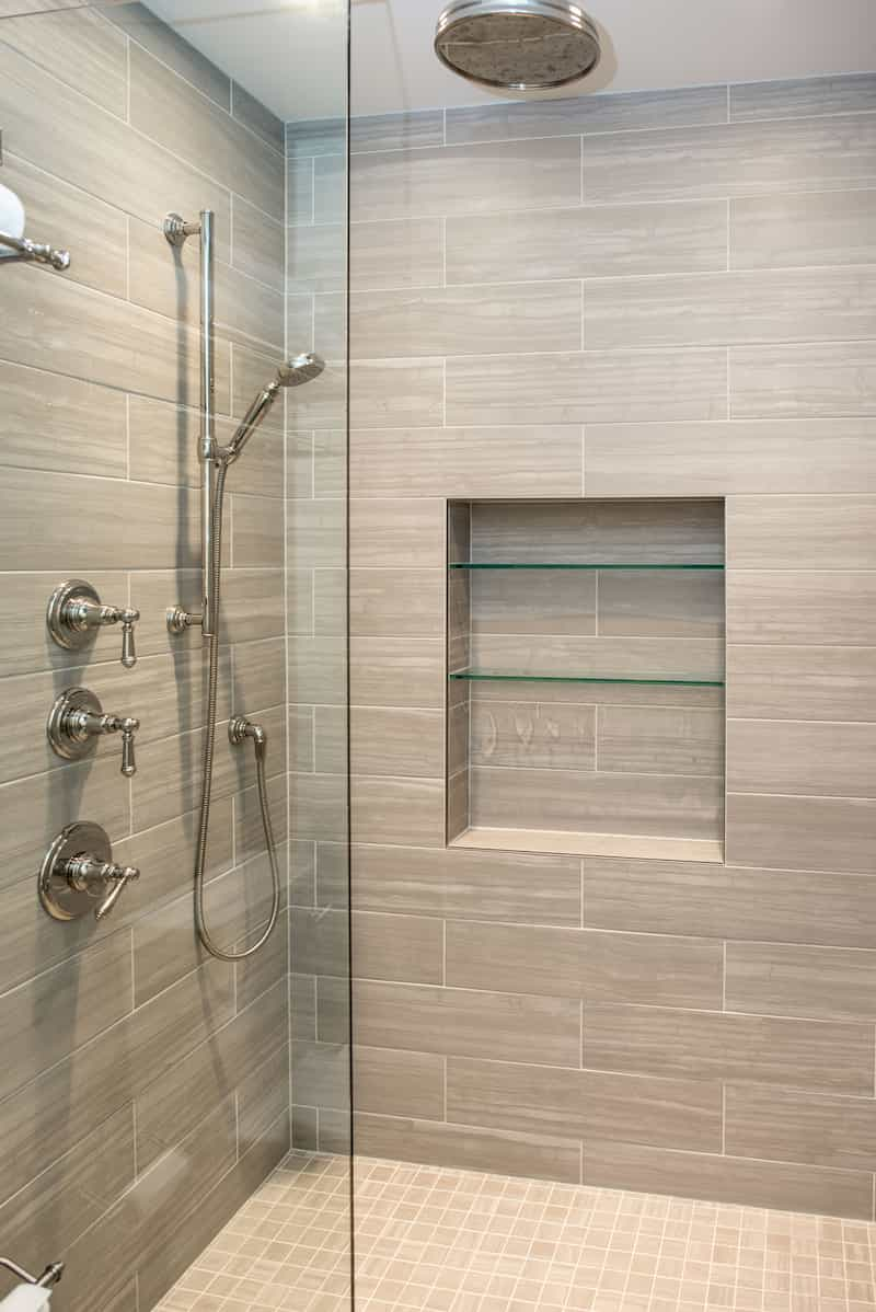 Luxury DADU Seattle builder - tile shower with glass divider