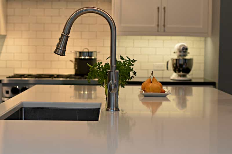 Brass faucet in remodeled Seattle kitchen