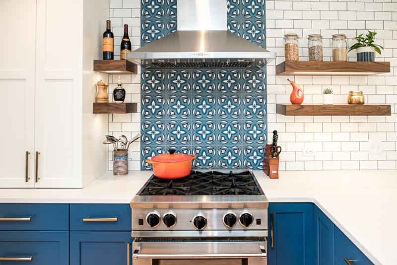 Kitchen with hand-made tile backsplash and open shelves