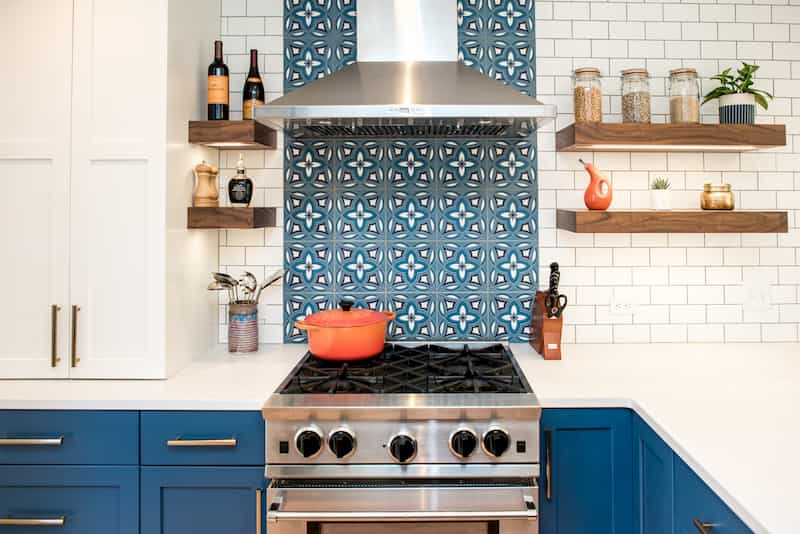 Remodeled Seattle kitchen with cement tile and professional-style range