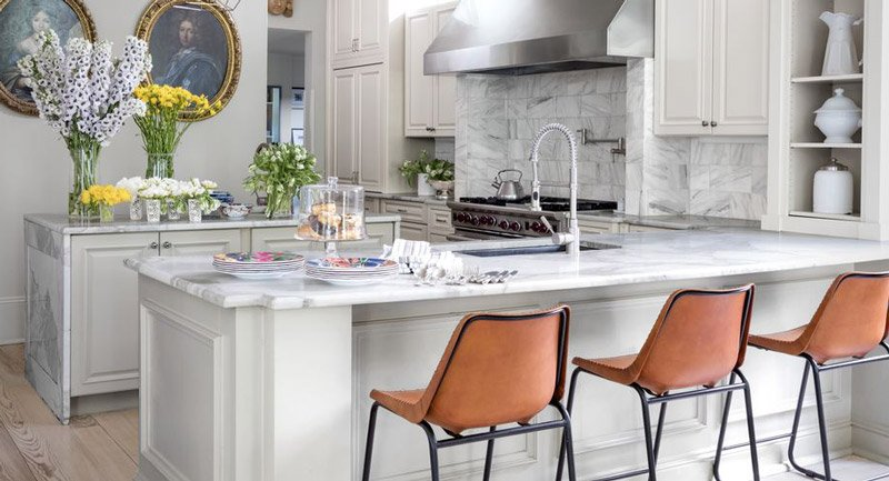 A kitchen peninsula extends the kitchen cabinetry
