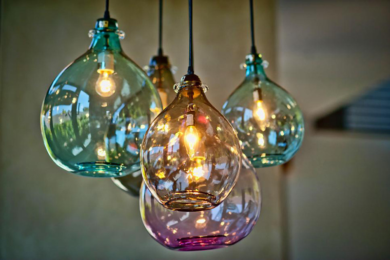 Why not use whimsical multi-colored glass lights to brighten up your peninsula?