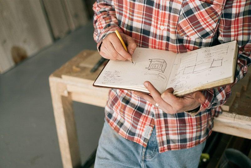 Carpenter drawing furniture sketches