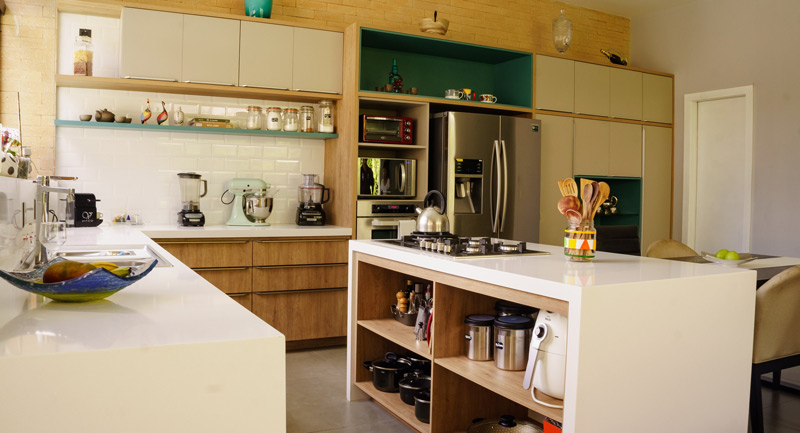modern furniture and appliances in spacious kitchen