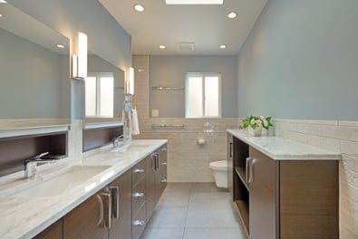 Photo of a master bath that shares a wall with a guest bath